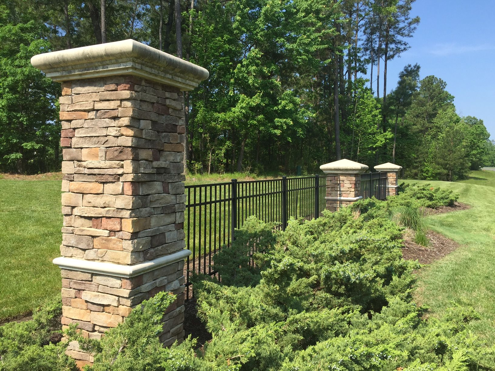 Stacked Stone Columns With Wrought Iron Fence Braemar